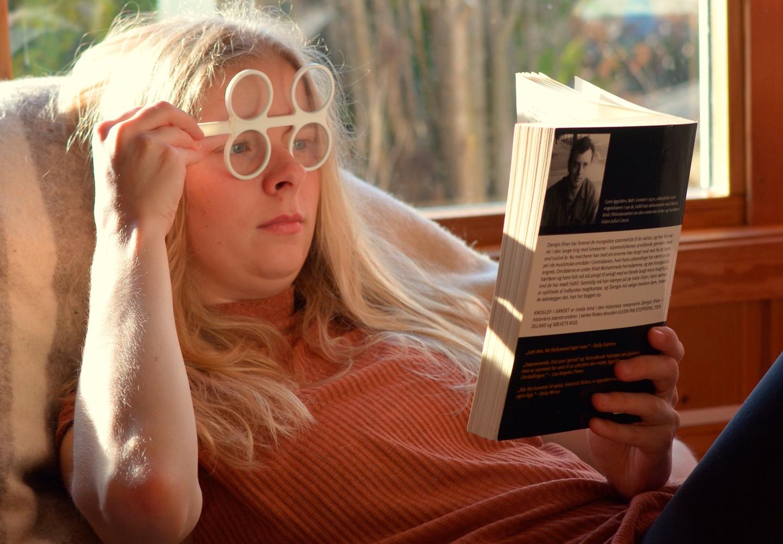 Lisa reading with Focusing Flipper glasses.